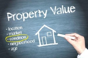 Property Value - Real Estate concept on blue background